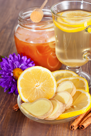Hot ginger lemon tea and honey photo