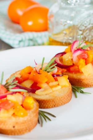 Bruschetta with fresh tomatoes, red onion, olive oil photo