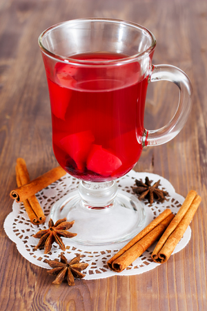 Glass of mulled wine, anise, cinnamon photo