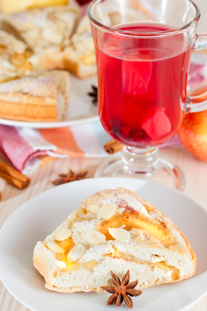 Portion of appple pie and mulled wine photo