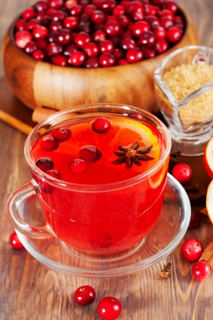 Hot mulled wine with cranberries and orange photo