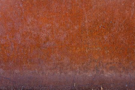 Rusty iron slab, heavily weathered