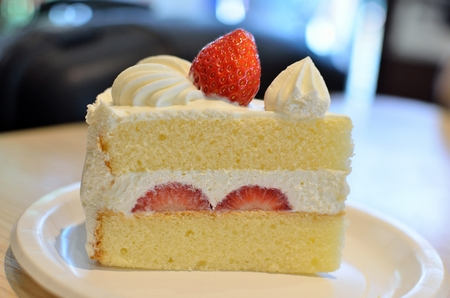 Close up Strawberry Shortcake on the table in Cafe