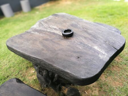 black  ashtray on table wooden background