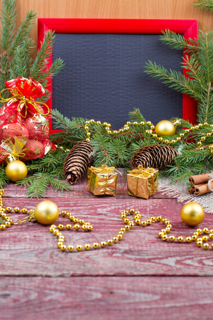 fir cones: Frame, christmas ornaments and fir cones on a wooden background