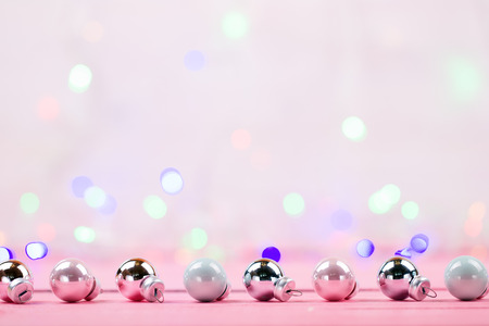 and brilliant: Brilliant christmas baubles and ornaments on a pink table