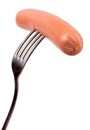 pork sausage: Raw frankfurter sausage on a fork isolated