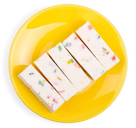 pastila: Fruit candy or pastila on a yellow saucer isolated on a white background