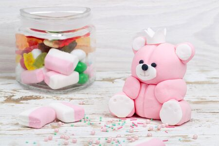 toppings: Sugar pink bear cub, toppings and candies in jar