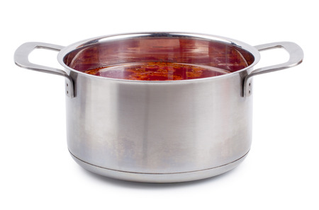 steel pan: Hot borsch in a steel pan isolated on a white background Foto de archivo