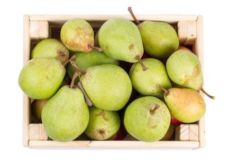 Wooden box full of fresh pears isolated on a white background. Top view Stock Photo