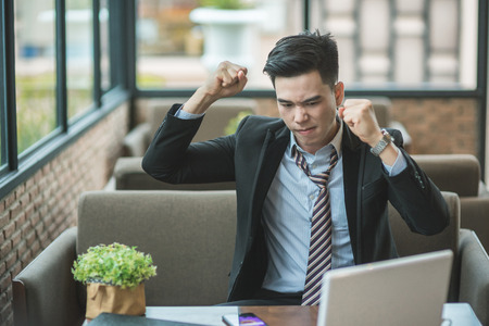 Angry senior businessman sitting at his desk and screaming, Angry businessman with too much work in office, Handsome stressed young man in glasses using laptop