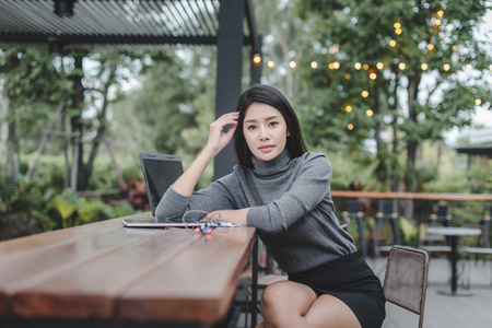 Modern business woman in the coffee shop with copy space Standard-Bild - 106389145