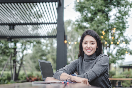 Modern business woman in the coffee shop with copy space Standard-Bild