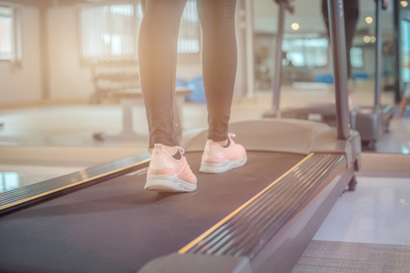 Close up on shoe, Women running in a gym on a treadmill. exercising concept. fitness and healthy lifestyle