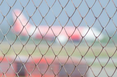 chainlink fence: Wire mesh airport Stock Photo