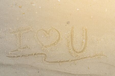 Letter I Love U of the alphabet writing on the sand Stock Photo