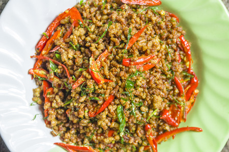 Regional thai southern style cuisine called name Spicy Mince Pork with Chili Paste or Kua Kling in dish whole put on brown sack. Thailand Stock Photo