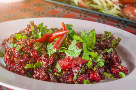 Sok Lek,Raw Beef and Blood in North Easrt or Isaan Local Food ,Thailand, That looks like and how to make the sauce., Foods made from fresh meat mixed with spices and cows blood. Stock Photo