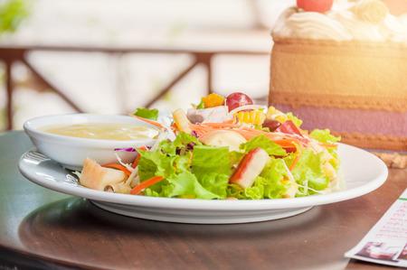 salad with dressing on dish.