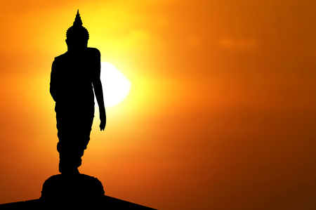Magha Asanha Visakha Puja Day , Silhouette Buddha on golden sunset background.