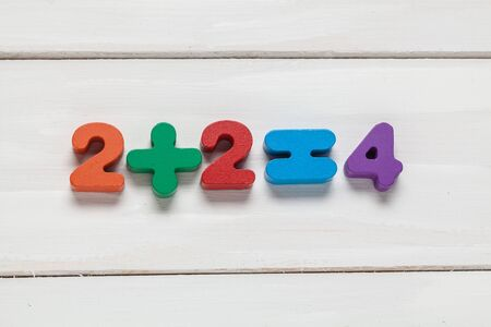 Color numeral on white wooden background