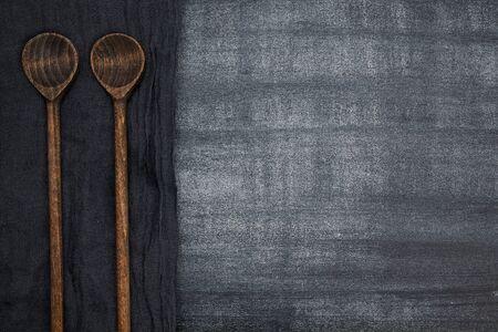 chalkboard on black board and wooden spoon