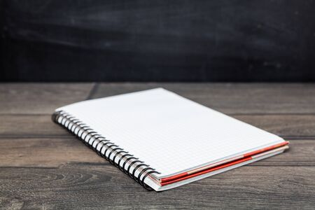 open notebook on wood background