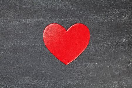 Red heart on black board Stock fotó