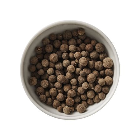 Allspice in bowl. Preparing ingredients for cooking. Banque d'images