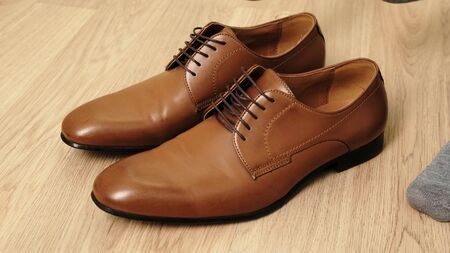 Man to wear his elegant brown shoes.