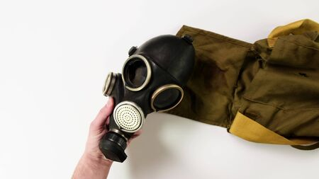 Hand with Gas Mask on white background. Close up.