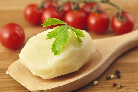 Boiled potatoes in the wooden poon, parsle board Close up Zdjęcie Seryjne