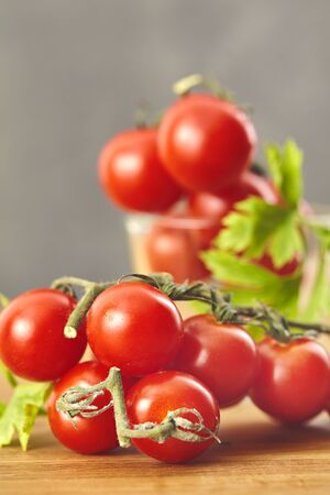 Fresh cherry tomatoes on a wooden table. Selective focus Stock Photo