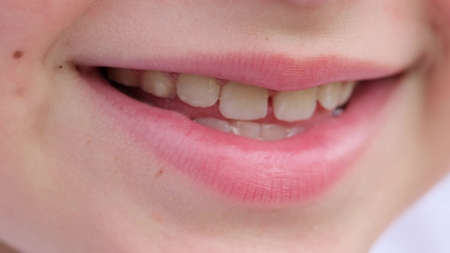 portrait of smiling teenager carefully looking at the camera. close-up Stock Photo