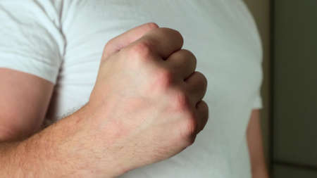 shake your fist to show aggression. close up 免版税图像