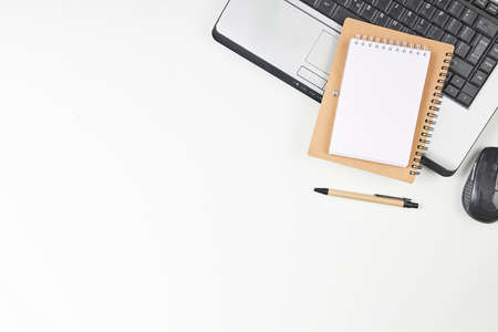 Top view of office desk table with slaptop and blank note paper. Top view, flay layout. Stock Photo