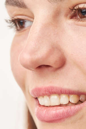closeup of smile girl with white healthy teeth