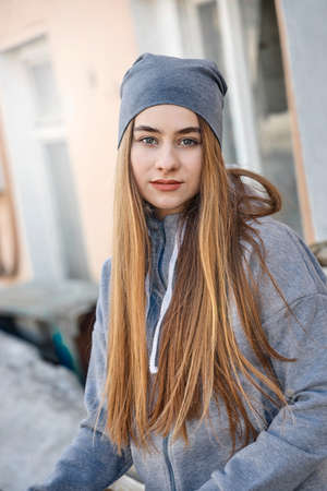 Portrait of the beautiful young girl on the city street Stock Photo