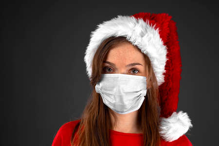 Young girl wearing a medical mask Santa hat red t-shirt attractive look close-up