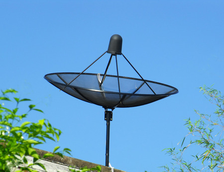 signle: Signle house satellite antenna on the roof Stock Photo