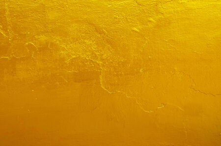 Yellow gold texture background on the back of buddha statue in temple photo