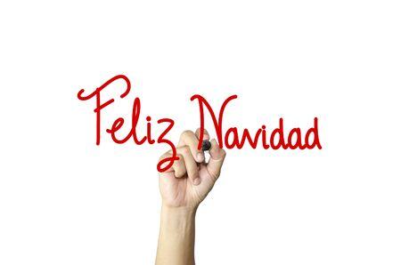 christmastide: Feliz Navidad hand writing on white isolated background
