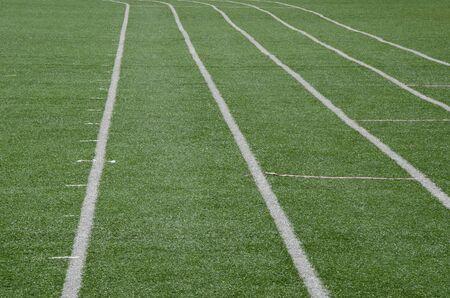 white line as running lane on the green grass Stock fotó