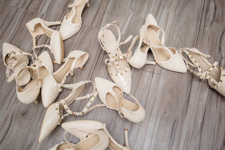 women shoes,high heel shoes on wooden floor