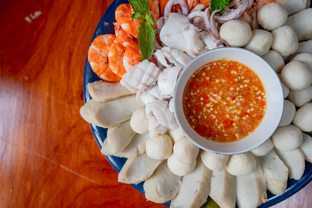 Steamed seafood, Fish ball, squid, shrimp served with spicy sauce, thai food