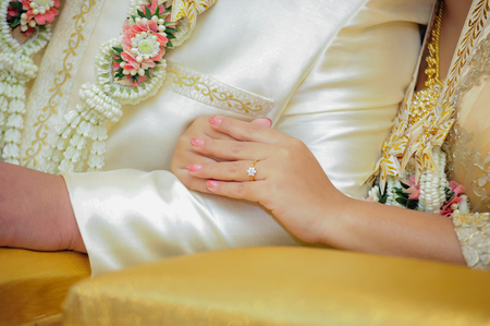 Hands of a wedding couple, Groom put a ring on finger of his lovely wife, wedding ceremony Stock Photo