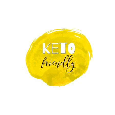 Keto friendly. Lettering on hand paint yellow texture isolated on white background. Ink dry brush stains, stroke, splash, smudge, scribble. Low carb high fat motivation quote menu poster.