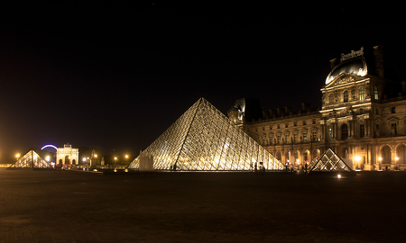 Louvre at night Stock Photo