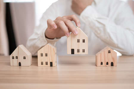 Business men are thinking hard about choosing a home and saving money. He is planning a future for his family and choosing the best money saving ideas. Energy saving financial analysis